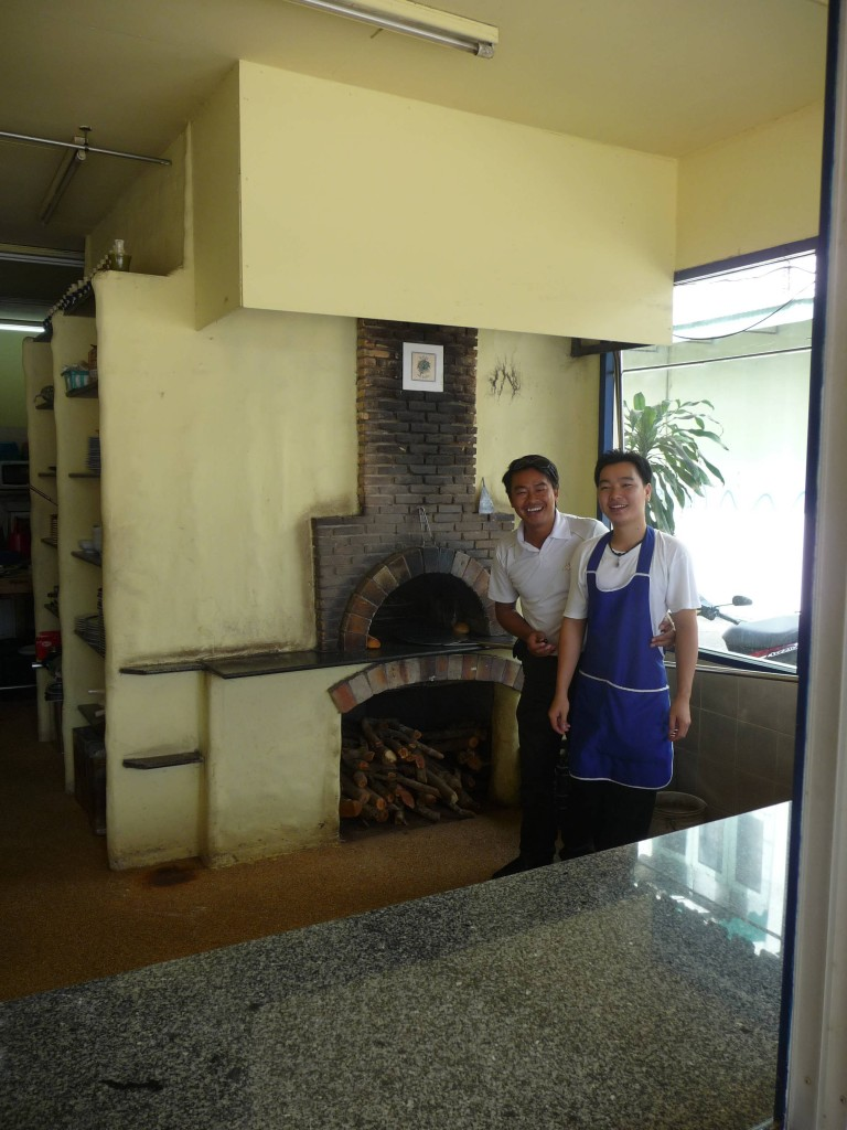 Thong checking out the woodfired pizza oven in Chiang Rai