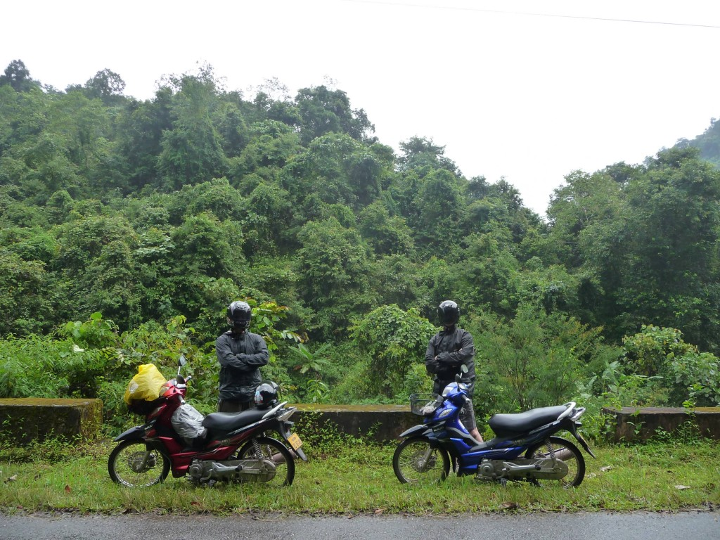 Dre and Tim riding to Muang Sing through  the National Protected Area