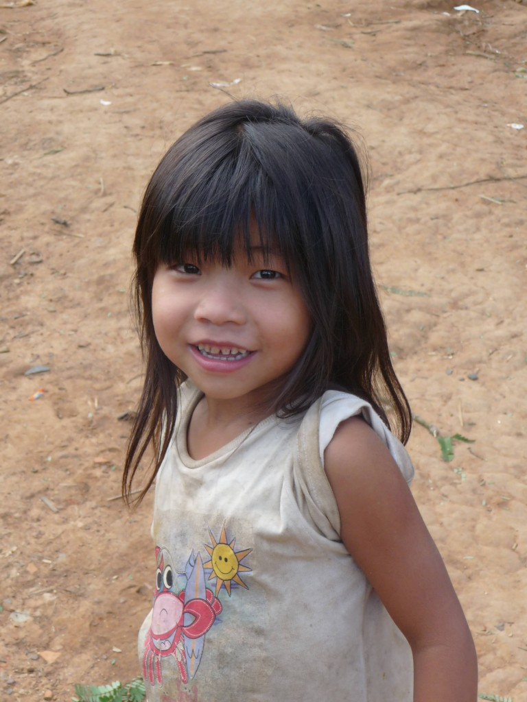 Beautiful Akha girl in a village near Muang Sing