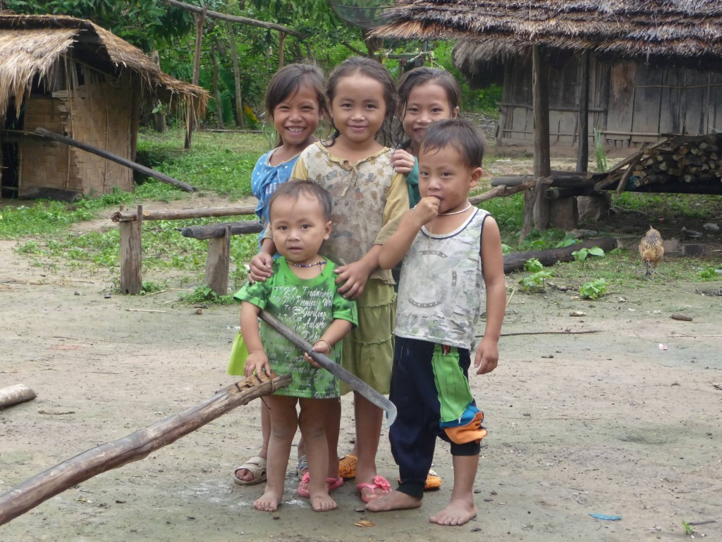 Never too young for a machete - beautiful Hmong children