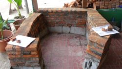 Building pizza oven in Laos