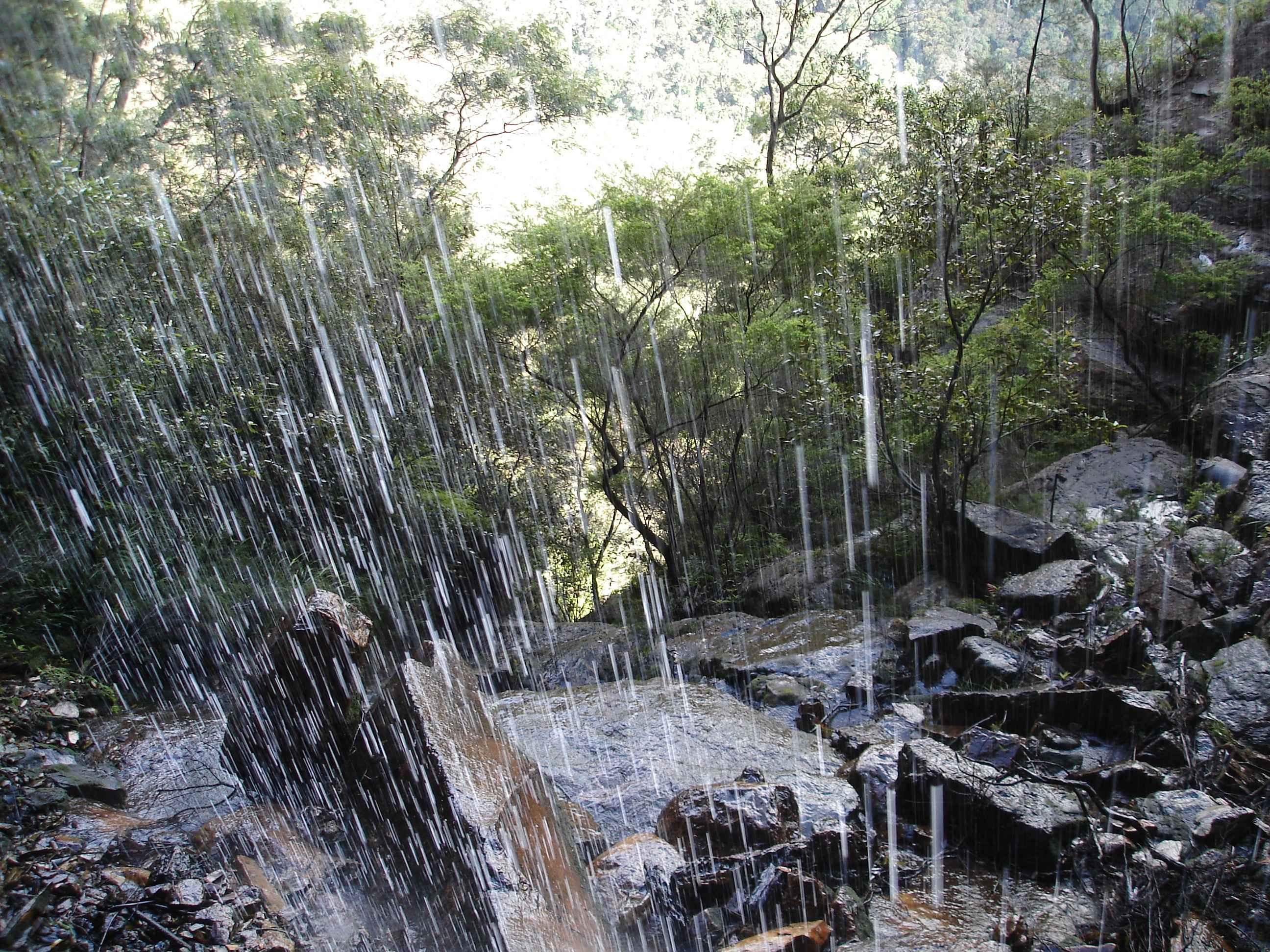 Standing behind waterfall.JPG
