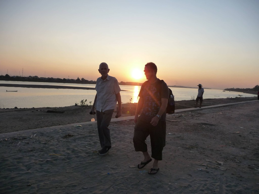 Garry and Dre walking in Vientiane along the Mekong