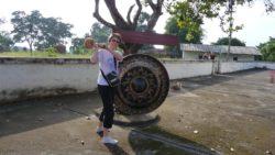 Hitting the gong at Muang Sing Stupa